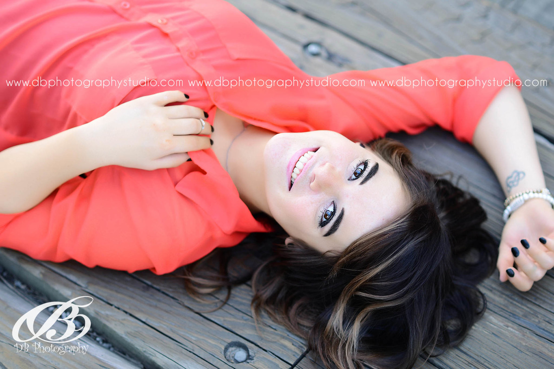 Central Arkansas Senior Photographer | McCrory Arkansas | DB Photography | Seniors by DB Photography | red shirt | laying down |